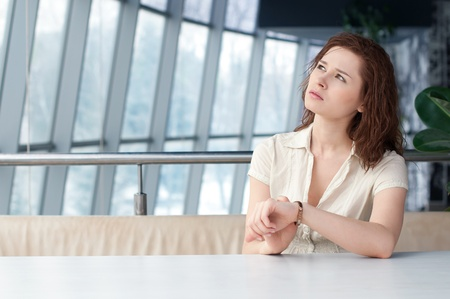 Emotional business woman with watch at office photo