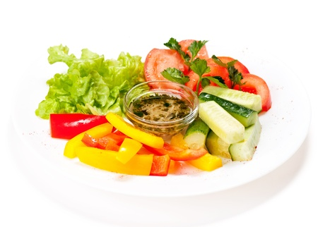 paprica: Fresh salad with tomaoto, cucumber, lettuce and pepper on plate isolated on white Stock Photo