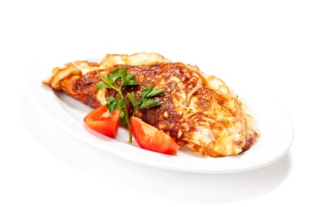 omelette: Omelet with herbs and tomatoes isolated on white