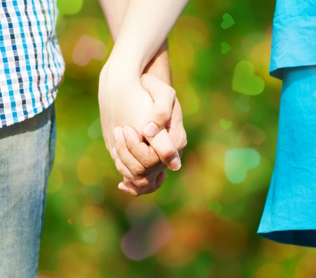 Concept shot of friendship and love of man and woman: two hands over green nature park Stock Photo - 12126117