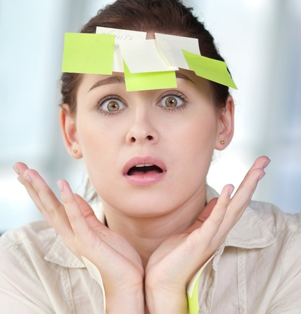 Portrait of emotional business woman with note papers Stock Photo - 12130000