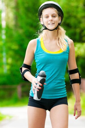 happy young woman on roller skates in the park Stock Photo - 12129998