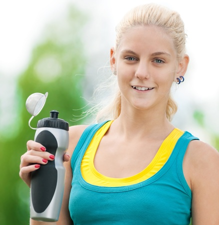 Young woman drinking water after fitness exercise Stock Photo - 12129988