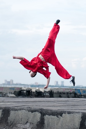Shaolin warriors wushoo man in red practice martial art outdoor. Kung fu Stock Photo - 12535272