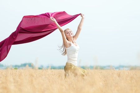 sexual activities: Young happy woman in wheat field with fabric. Summer picnic