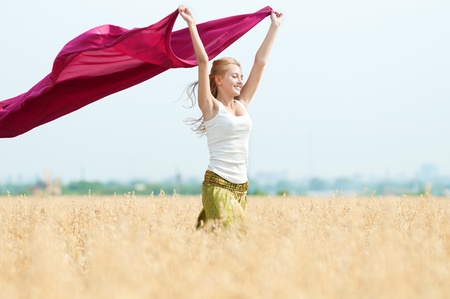 Young happy woman in wheat field with fabric. Summer picnic Stock Photo - 12535246