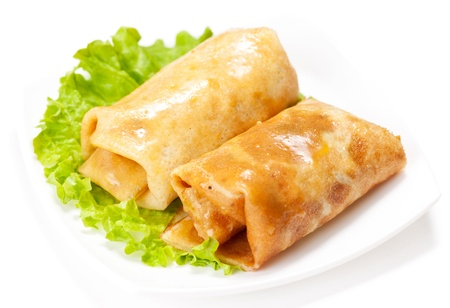 Rolled pancakes stuffed with lettuce. Rusian blini isolated in white Stock Photo - 12584707