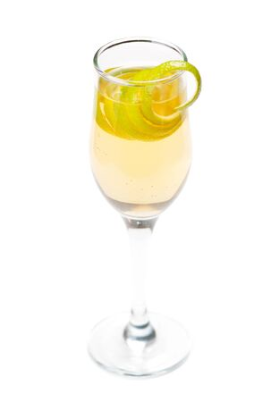 Yellow cocktail in glass with lime twist isolated on a white background Stock Photo - 12584663
