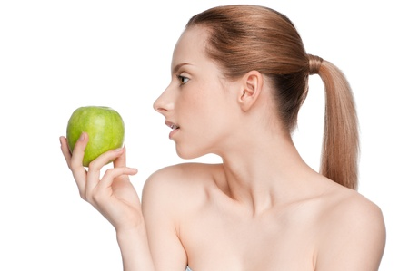 Young woman eat green apple photo
