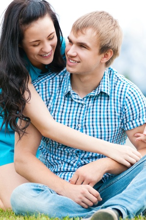 Portrait of a beautiful young happy smiling couple - green park outdoor Stock Photo - 12535424