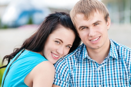 Portrait of a beautiful young happy smiling couple - green park outdoor Stock Photo - 12535416