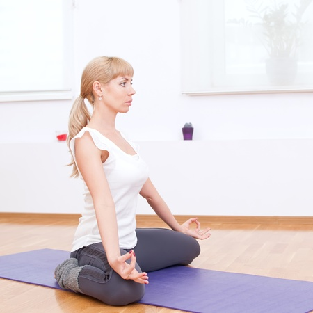 Beautiful sport woman doing stretching fitness exercise at sport gym. Yoga  Stock Photo - 12535336