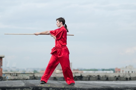 Shaolin warriors wushoo man in red practice martial art outdoor. Kung fu Stock Photo - 12535634