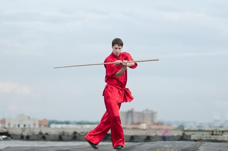 Shaolin warriors wushoo man in red practice martial art outdoor. Kung fu Stock Photo - 12535612