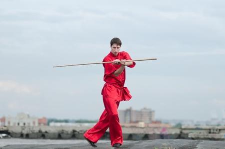 Shaolin warriors wushoo man in red practice martial art outdoor. Kung fu Stock Photo - 12535612