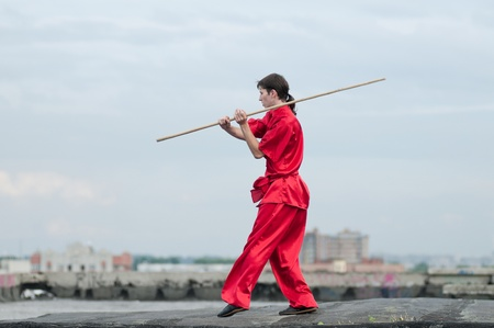 Shaolin warrs wushoo man in red practice martial art outdoor. Kung fu Stock Photo - 12535626