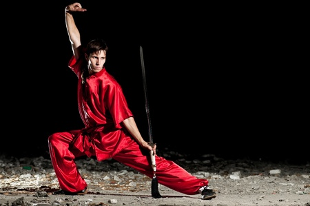 Shaolin warriors wushoo man in red practice martial art outdoor. Kung fu Stock Photo - 12535625