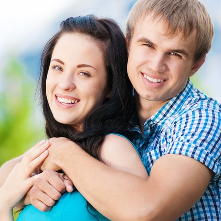 Young couple playing around in the nature - city park outdoor photo