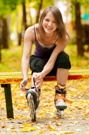 happy young woman on roller skates in the autumn park Stock Photo - 12872289