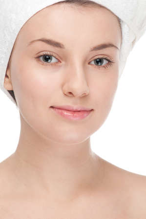 Close-up portrait of young woman with perfect health skin of face and bath towel on head. Isolated on white Stock Photo - 12872129