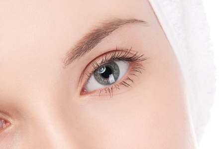 Close-up portrait of woman eye with perfect health skin of face. Isolated on white Stock Photo
