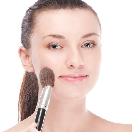 Close-up portrait of young beautiful woman with brush for make-up. Cheek zone Stock Photo - 12872283