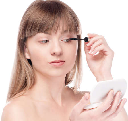 Close-up portrait of young beautiful woman with brush for make-up. Mascara, eye zone Stock Photo - 12872200