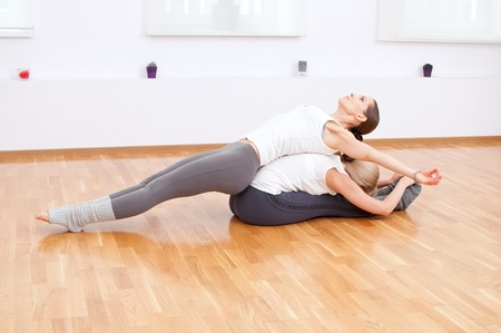 Group of sport women in the gym centre doing stretching fitness exercise. Yoga photo