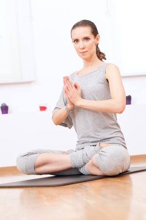 Beautiful sport woman doing stretching fitness exercise at sport gym. Yoga Stock Photo - 12871858
