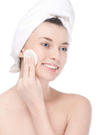 Close-up portrait of young woman with perfect health skin of face and bath towel on head. Isolated on white Stock Photo - 13303672