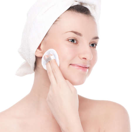 Close-up portrait of young woman with perfect health skin of face and bath towel on head. Isolated on white Stock Photo - 13303624