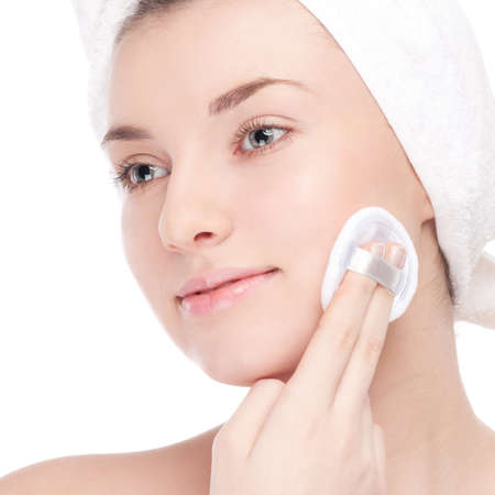 Close-up portrait of young woman with perfect health skin of face and bath towel on head. Isolated on white Stock Photo - 13303632