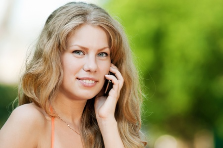 Young happy woman with mobile phone. SMS photo