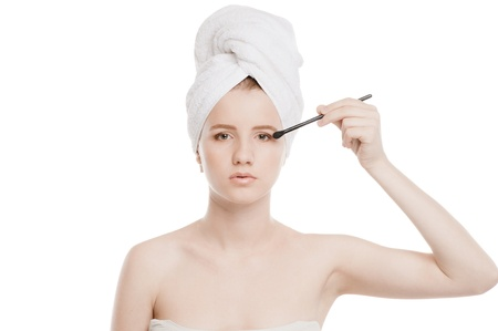 Close-up portrait of young beautiful woman with brush for make-up. Eye zone Stock Photo - 13330016