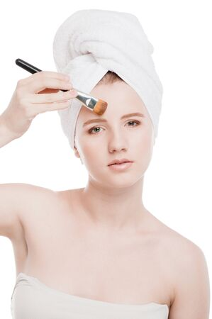 Close-up portrait of young beautiful woman with brush for make-up. Eyebrow zone Stock Photo - 13330031