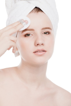 Close-up portrait of young woman with perfect health skin of face, bath towel on head and clean sponge. Isolated on white photo