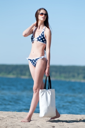 Beautiful Summer Woman on the Beach with white bag Stock Photo - 13621671