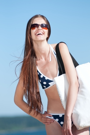Beautiful Summer Woman on the Beach with white bag Stock Photo - 13622196