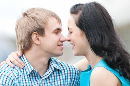 Portrait of a beautiful young happy smiling couple - green park outdoor photo
