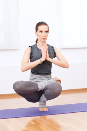 Beautiful sport woman doing stretching fitness exercise at sport gym. Yoga Stock Photo - 13621555