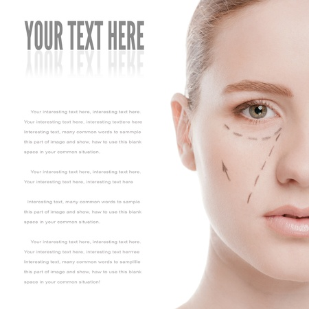 Beautician draw correction lines on woman face. Before plastic surgery operetion. Isolated on white Stock Photo - 13622219