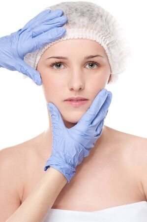 Medical face examination of beautiful woman by hands in glove - close-up portrait isolated on white Stock Photo - 13622199