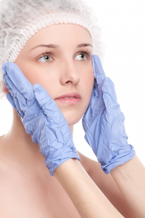 Medical face examination of beautiful woman by hands in glove - close-up portrait isolated on white Stock Photo - 13622222