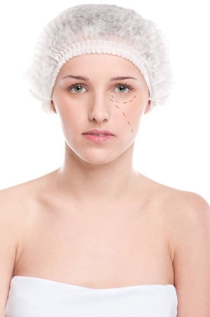 Beautician draw correction lines on woman face. Before plastic surgery operetion. Isolated on white Stock Photo - 13622154