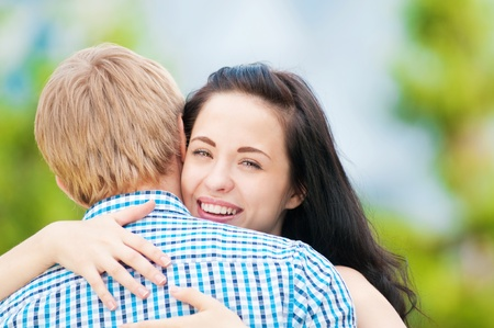 Portrait of a beautiful young happy smiling couple - hugging with love photo