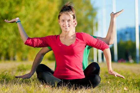 Young man and woman woman doing yoga in the sunny summer park Stock Photo - 13947322