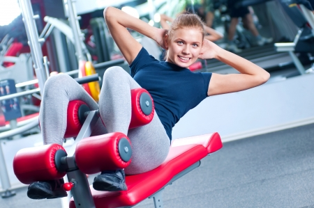 Woman at the gym exercising on a machine  Stock Photo - 13947041