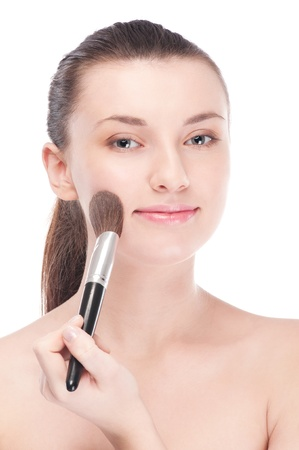 Close-up portrait of young beautiful woman with brush for make-up. Cheek zone Stock Photo - 14345955