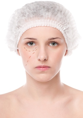 correction lines: Beautician draw correction lines on woman face. Before plastic surgery operation. Isolated on white Stock Photo
