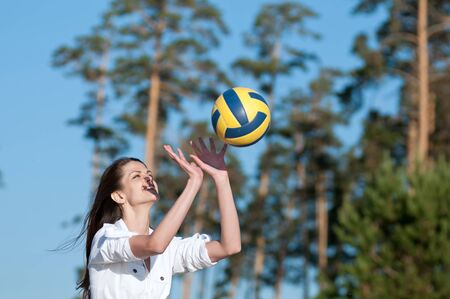 Young beautiful woman playing volleyball on beach Stock Photo - 15262730